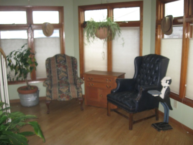 The wing chairs have moved to a sunny alcove for reading or thinking.